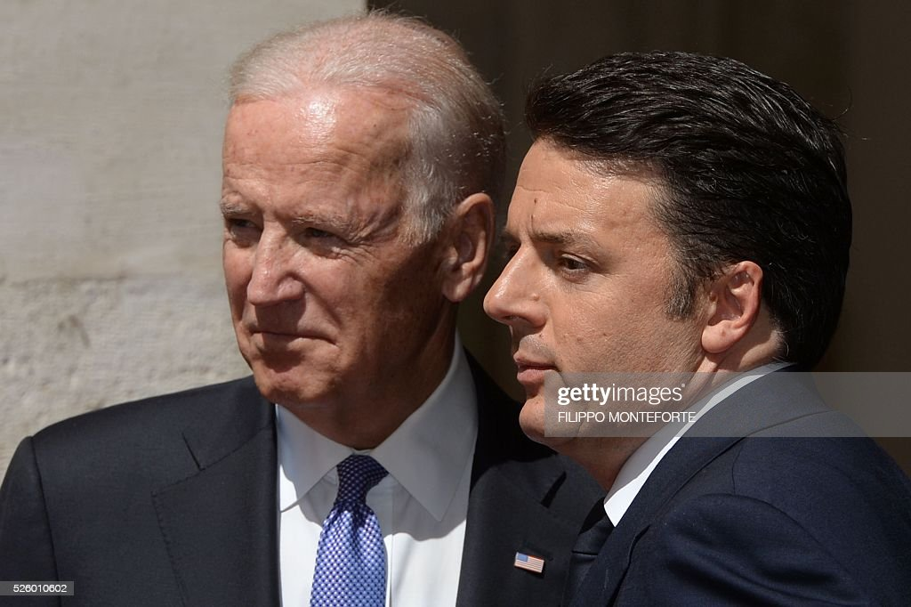 Italian Prime Minister Matteo Renzi (R) welcomes US Vice-President Joe Biden prior their meeting on April 29, 2016 at the Palazzo Chigi in Rome. Earlier today, Biden, whose 46-year old son Beau Biden died from brain cancer last year, made an emotional speech at a stem cell summit thanking Pope Francis for his support and for counselling his family during his visit to the United States. / AFP / Filippo MONTEFORTE