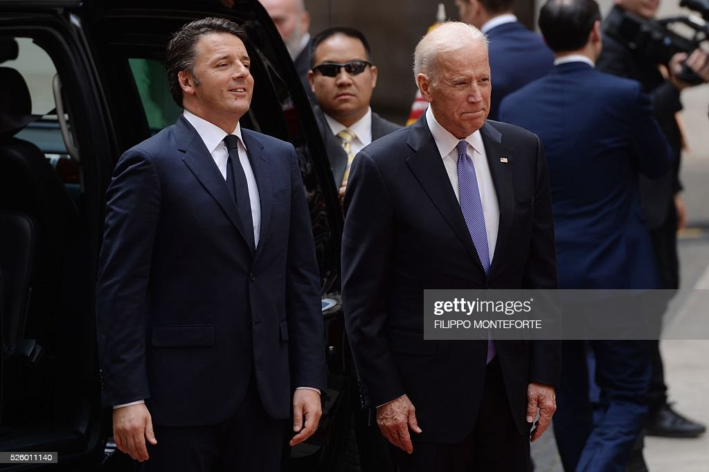 Italian Prime Minister Matteo Renzi (L) welcomes US Vice-President Joe Biden prior their meeting on April 29, 2016 at the Palazzo Chigi in Rome. Earlier today, Biden, whose 46-year old son Beau Biden died from brain cancer last year, made an emotional speech at a stem cell summit thanking Pope Francis for his support and for counselling his family during his visit to the United States.
