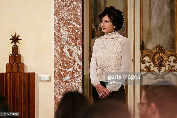 Italian Prime Minister Matteo Renzi's wife Agnese Landini is seen as Renzi gives a speech after the results of the referendum on constitutional...