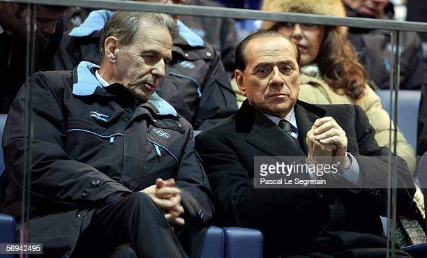 Italian Prime Minister of Italy Silvio Berlusconi sits with Jacques Rogge the president of the IOC during the Closing Ceremony of the Turin 2006...