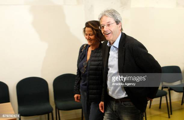 Italian Prime Minister Paolo Gentiloni and his wife Emanuela Mauro arrive to vote at the primary elections of the Italian Democratic Party leadership...