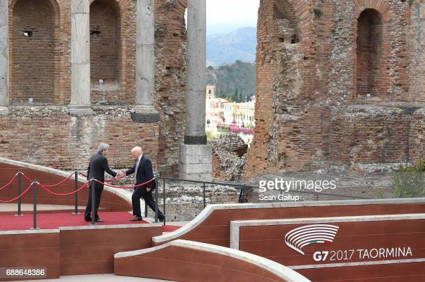 Italian Prime Minister Paolo Gentiloni greets US President Donald Trump in the ancient amphiteater at the G7 Taormina summit on the island of Sicily...