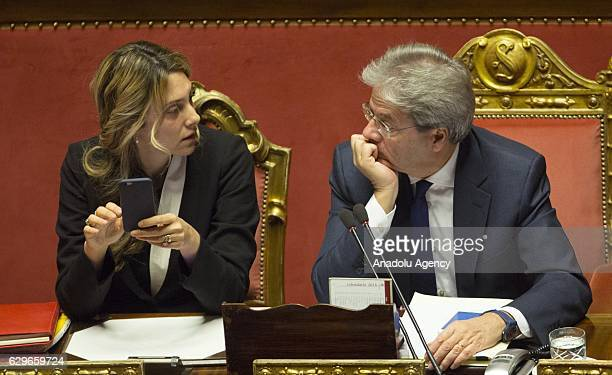 Italian Prime Minister Paolo Gentiloni listens to Public Administration and Simplification Minister Marianna Madia during a plenary session at the...