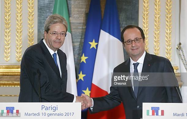 Italian Prime Minister Paolo Gentiloni shakes hand with French President Francois Hollande after their joint press conference at the Elysee...