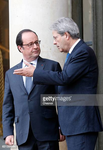 Italian Prime Minister Paolo Gentiloni speakes with French President Francois Hollande after their press conference at the Elysee Presidential Palace...