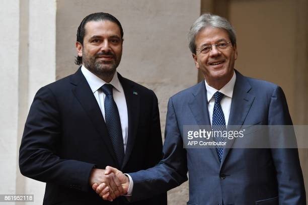 Italian Prime Minister Paolo Gentiloni welcomes his Lebanese counterpart Saad Hariri before their meeting on October 16 2017 at the Palazzo Chigi in...