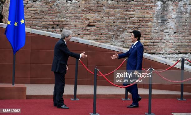 Italian Prime Minister Paolo Gentiloni welcomes Japanese Prime Minister Shinzo Abe as he arrives for the Summit of the Heads of State and of...
