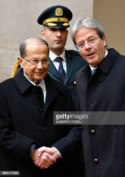 Italian Prime Minister Paolo Gentiloni welcomes Lebanese President Michel Aoun before their meeting on December 1 2017 at the Palazzo Chigi in Rome /...