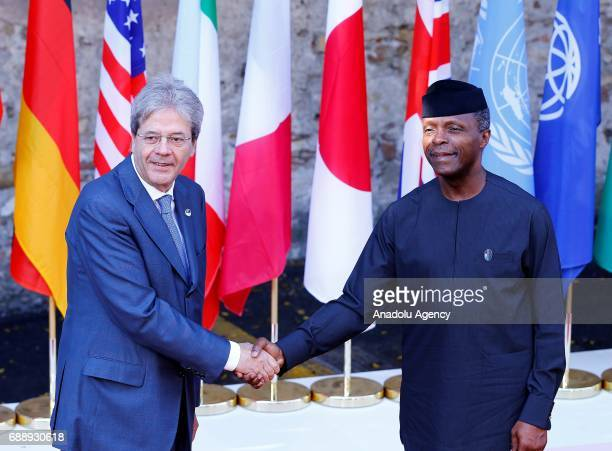 Italian Prime Minister Paolo Gentiloni welcomes Nigerian President Muhammadu Buhari prior to the ''Innovation and Development in Africa'' session on...