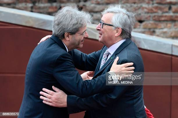 Italian Prime Minister Paolo Gentiloni welcomes President of the European Commission JeanClaude Juncker at the ancient Greek Theatre of Taormina...
