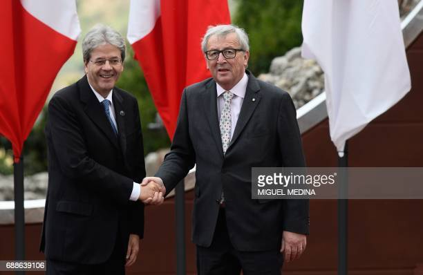 Italian Prime Minister Paolo Gentiloni welcomes President of the European Commission JeanClaude Juncker as he arrives for the Summit of the Heads of...