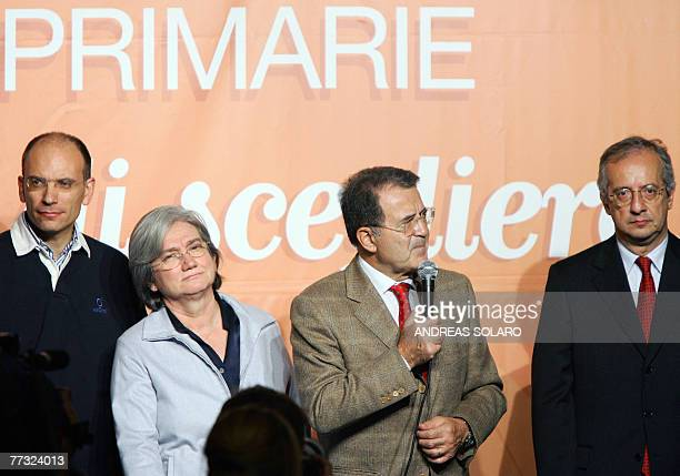 Italian Prime Minister Romano Prodi speaks to the media press flanked by candidates to lead the new Democratic Party Rome's Mayor Walter Veltroni...