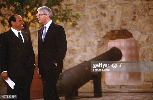Italian Prime Minister Silvio Berlusconi and British Prime Minister John Major attend a working dinner for the international leaders at Castel...