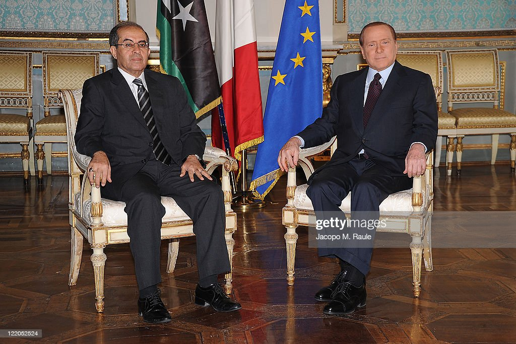 Italian Prime Minister Silvio Berlusconi (R) and Deputy chairman of the National Transitional Council Executive Board attend a meeting on August 25, 2011 in Milan, Italy. Berlusconi met Mahmoud Jibril today to discuss the future of Libya in the wake of the collapse of Muammar Gaddafi's regime and discuss an Italian aid plan.