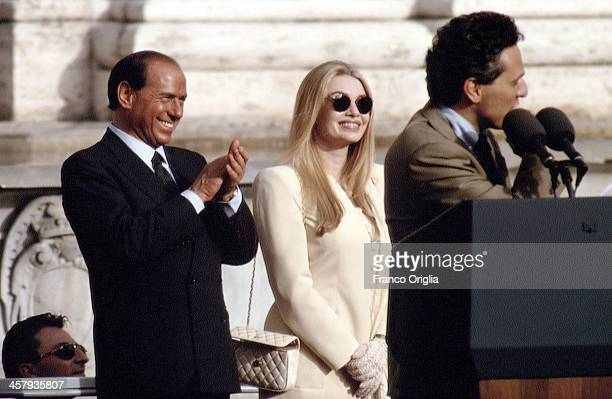 Italian Prime Minister Silvio Berlusconi and his second wife Veronica Lario applaud as Mayor of Rome Francesco Rutelli holds a speech from the...