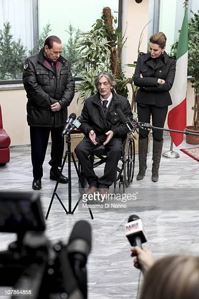 Italian Prime Minister Silvio Berlusconi and Italian politician Daniela Santanche face media alongside Alberto Torregiani the son Pierluigi...