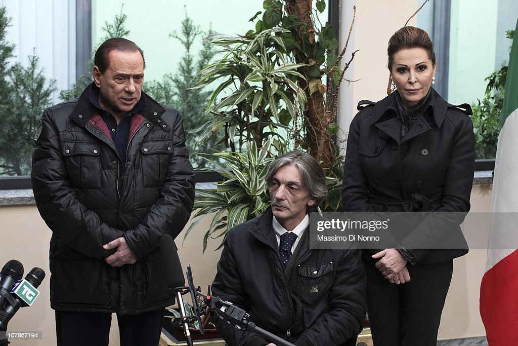 Italian Prime Minister <a gi-track='captionPersonalityLinkClicked' href=/galleries/search?phrase=Silvio+Berlusconi&family=editorial&specificpeople=201842 ng-click='$event.stopPropagation()'>Silvio Berlusconi</a> (L) and Italian politician Daniela Santanche (R) face media alongside Alberto Torregiani, the son of Pierluigi Torregiani, at Linate military airport on January 04, 2011 in Milan, Italy. Alberto Torregiani was shot in the back and was left paralysed during the same gunfight in which his father jeweler Pierluigi Torregiani was killed by militant group PAC (Armed Proletarians for Communism) in 1979. Italy has recalled its ambassador to Brazil to following former Brazilian President Luiz Inacio Lula da Silva's decision on his final day in office not to approve the extradition of Cesare Battisti, deemed responsible for the attack and convicted for a string of murders in the 1970s for which he was tried and convicted in absentia.
