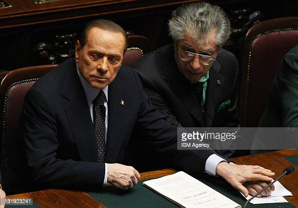 Italian Prime Minister Silvio Berlusconi and Reform Minister Umberto Bossi attend a vote at the Chamber of Deputies on November 8 2011 in Rome Italy...