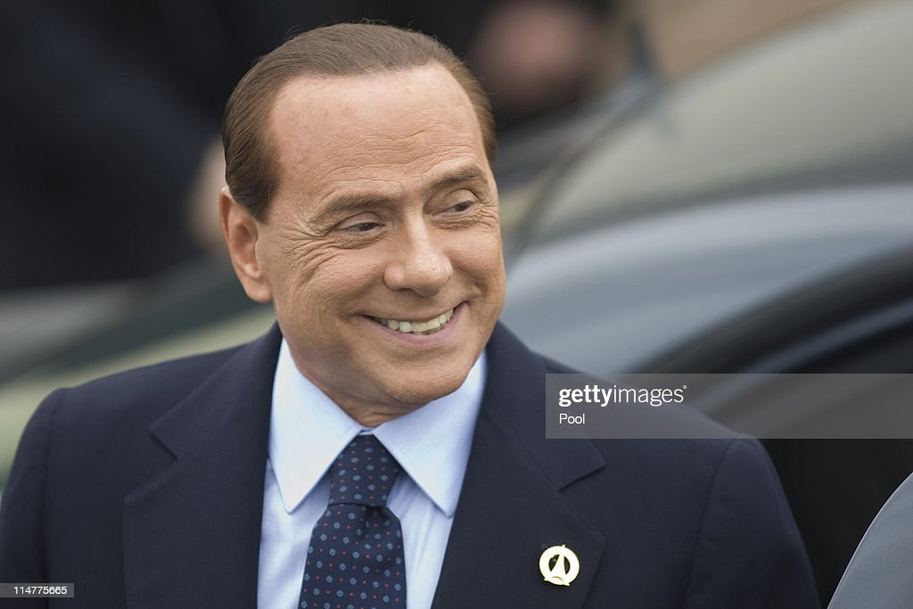 Italian Prime Minister, <a gi-track='captionPersonalityLinkClicked' href=/galleries/search?phrase=Silvio+Berlusconi&family=editorial&specificpeople=201842 ng-click='$event.stopPropagation()'>Silvio Berlusconi</a> arrives for an evening dinner function at Le Ciro's Restaurant at the G8 Summit on May 26, 2011 in Deauville, France. Heads of the world's wealthiest nations are meeting in Deauville, France, for the G8 summit to discuss various security, aid and trade issues, including the 'Arab Spring', nuclear safety and climate change.