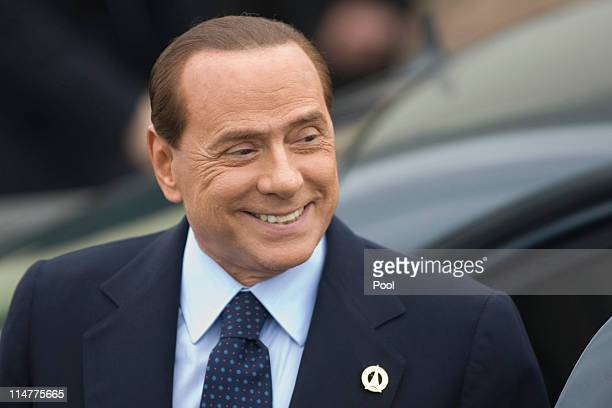 Italian Prime Minister Silvio Berlusconi arrives for an evening dinner function at Le Ciro's Restaurant at the G8 Summit on May 26 2011 in Deauville...