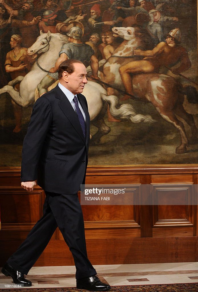 Italian Prime Minister Silvio Berlusconi arrives with his Bulgarian counterpart Boyko Borisov (unseen) prior to their meeting on May 21, 2010 at Palazzo Chigi in Rome. AFP PHOTO/ Tiziana Fabi