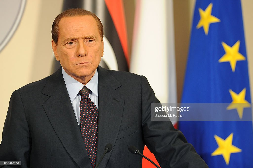 Italian Prime Minister <a gi-track='captionPersonalityLinkClicked' href=/galleries/search?phrase=Silvio+Berlusconi&family=editorial&specificpeople=201842 ng-click='$event.stopPropagation()'>Silvio Berlusconi</a> attends a meeting and press conference with Deputy chairman of the National Transitional Council Executive Board Mahmoud Jibril (not pictured) at the Prefecture Palace on August 25, 2011 in Milan, Italy. Following their meeting Berlusconi announced that Italy would unfreeze Libyan assets estimated at Euro350 million (USD 505 million). The figure is one part of the financial assistance which the National Transition Council (NTC) is seeking from the international community in order to maintain core salaries, services and infrastructure as the rebels seek to seize full control of Tripoli and Libya.