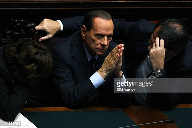 Italian Prime Minister Silvio Berlusconi attends a vote at the Italian Chamber of Deputies on September 14 2011 in Rome Italy Silvio Berlusconi's...