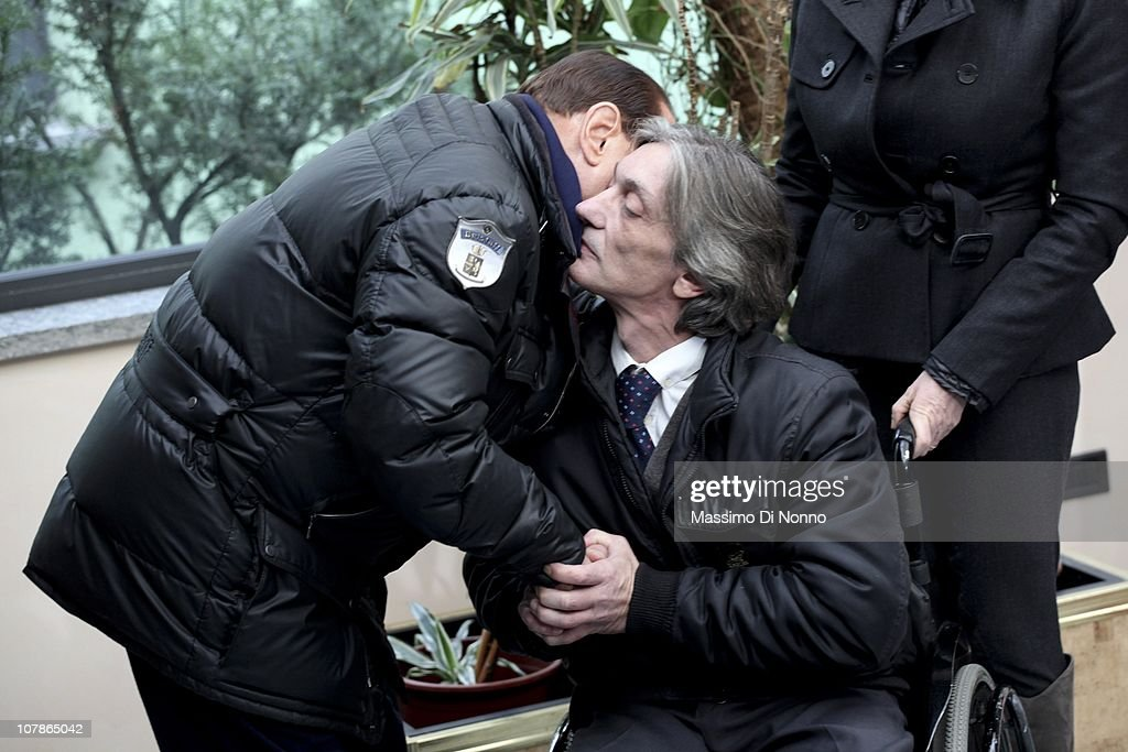 Italian Prime Minister <a gi-track='captionPersonalityLinkClicked' href=/galleries/search?phrase=Silvio+Berlusconi&family=editorial&specificpeople=201842 ng-click='$event.stopPropagation()'>Silvio Berlusconi</a> (L) embraces Alberto Torregiani, the son of Pierluigi Torregiani at a press conference at Linate military airport on January 04, 2011 in Milan, Italy. Alberto Torregiani was shot in the back and was left paralysed during the same gunfight in which his father jeweler Pierluigi Torregiani was killed by militant group PAC (Armed Proletarians for Communism) in 1979. Italy has recalled its ambassador to Brazil to following former Brazilian President Luiz Inacio Lula da Silva's decision on his final day in office not to approve the extradition of Cesare Battisti, deemed responsible for the attack and convicted for a string of murders in the 1970s for which he was tried and convicted in absentia.