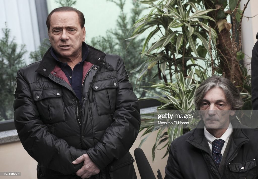 Italian Prime Minister <a gi-track='captionPersonalityLinkClicked' href=/galleries/search?phrase=Silvio+Berlusconi&family=editorial&specificpeople=201842 ng-click='$event.stopPropagation()'>Silvio Berlusconi</a> (L) faces a media gathering alongside Alberto Torregiani, the son of Pierluigi Torregiani, at Linate military airport on January 04, 2011 in Milan, Italy. Alberto Torregiani was shot in the back and was left paralysed during the same gunfight in which his father jeweler Pierluigi Torregiani was killed by militant group PAC (Armed Proletarians for Communism) in 1979. Italy has recalled its ambassador to Brazil to following former Brazilian President Luiz Inacio Lula da Silva's decision on his final day in office not to approve the extradition of Cesare Battisti, deemed responsible for the attack and convicted for a string of murders in the 1970s for which he was tried and convicted in absentia.