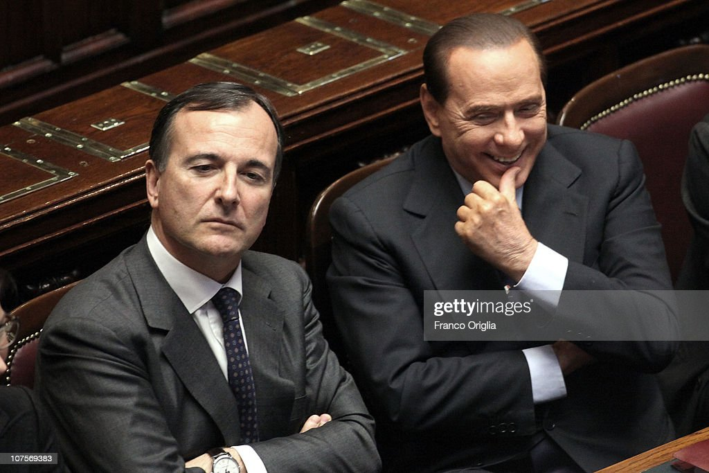 Italian Prime Minister <a gi-track='captionPersonalityLinkClicked' href=/galleries/search?phrase=Silvio+Berlusconi&family=editorial&specificpeople=201842 ng-click='$event.stopPropagation()'>Silvio Berlusconi</a> (R), flanked by foreign minister <a gi-track='captionPersonalityLinkClicked' href=/galleries/search?phrase=Franco+Frattini&family=editorial&specificpeople=536993 ng-click='$event.stopPropagation()'>Franco Frattini</a> smile during the confidence vote to his government at the Lower house on December 14, 2010 in Rome, Italy. Italian Prime Minister <a gi-track='captionPersonalityLinkClicked' href=/galleries/search?phrase=Silvio+Berlusconi&family=editorial&specificpeople=201842 ng-click='$event.stopPropagation()'>Silvio Berlusconi</a> faced a vote of no confidence from both the Senate and the Lower House but won both counts.