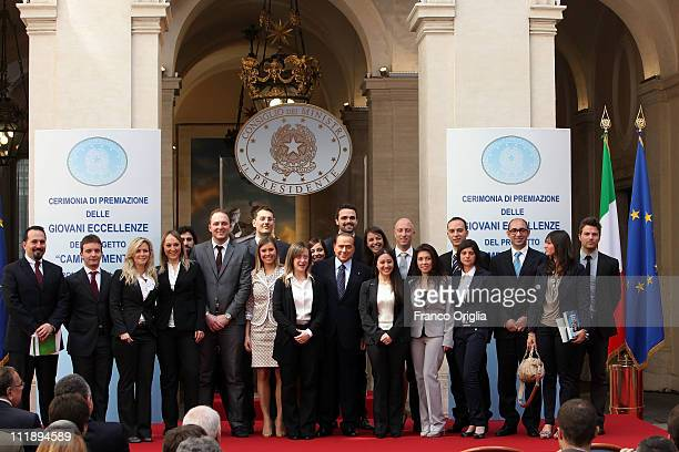 Italian Prime Minister Silvio Berlusconi flanked by Italian Minister of the Youth Giorgia Meloni poses for the family photo during the 'Campus...