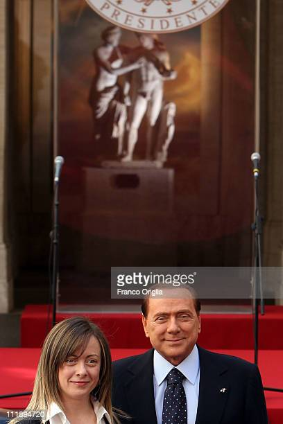 Italian Prime Minister Silvio Berlusconi flanked by Italian Minister of the Youth Giorgia Meloni attends 'Campus Mentis' Awards at Palazzo Chigi on...