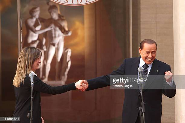 Italian Prime Minister Silvio Berlusconi flanked by the Italian Minister of the Youth Giorgia Meloni tells a joke during the 'Campus Mentis' Awards...