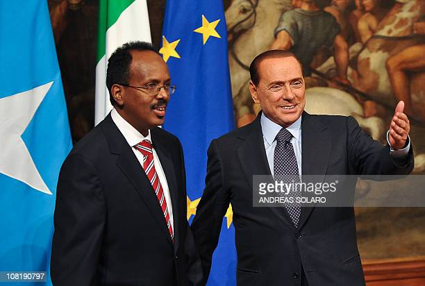 Italian Prime Minister Silvio Berlusconi gestures as he greets his Somali counterpart Mohamed Abdullahi Mohamed before their meeting on January 20...