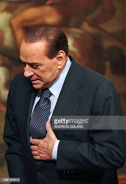 Italian Prime Minister Silvio Berlusconi gestures as he welcomes his Somali counterpart Mohamed Abdullahi Mohamed before their meeting on January 20...
