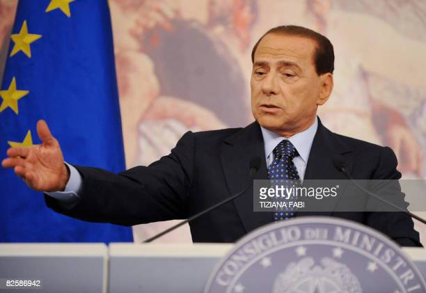 Italian Prime Minister Silvio Berlusconi gestures during a press conference about a new foreign company forming an alliance with Alitalia to save the...