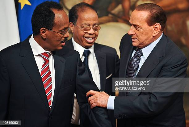 Italian Prime Minister Silvio Berlusconi greets his Somali counterpart Mohamed Abdullahi Mohamed before their meeting on January 20 2011 at Palazzo...