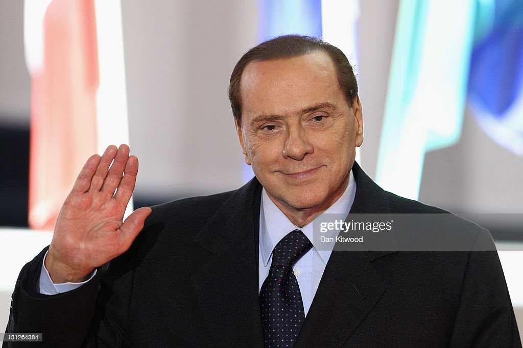 Italian Prime Minister Silvio Berlusconi leaves the conference centre after the first day of the G20 Summit on November 3, 2011 in Cannes, France. World's top economic leaders are attending the G20 summit in Cannes on November 3rd and 4th, and are expected to debate current issues surrounding the global financial system in the hope of fending off a global recession and finding an answer to the Eurozone crisis.