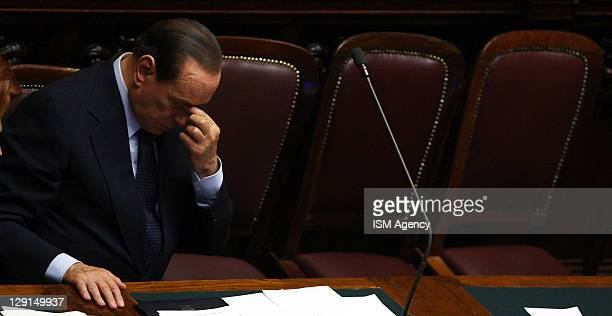 Italian Prime Minister Silvio Berlusconi reacts during a session of Italian Chamber of Deputies at Palazzo Montecitorio on October 13 2011 in Rome...