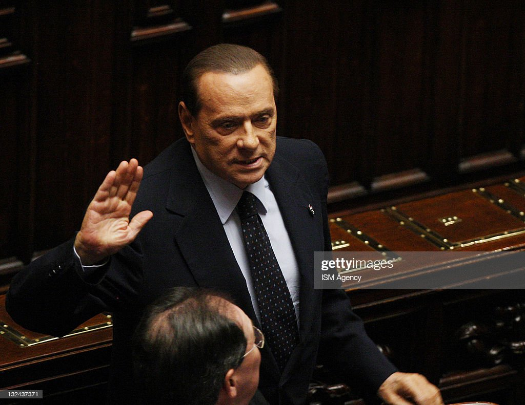 Italian Prime Minister <a gi-track='captionPersonalityLinkClicked' href=/galleries/search?phrase=Silvio+Berlusconi&family=editorial&specificpeople=201842 ng-click='$event.stopPropagation()'>Silvio Berlusconi</a> reacts during a vote on 2012 budget law on November 12, 2011 in Rome, Italy. Italian Prime Minister <a gi-track='captionPersonalityLinkClicked' href=/galleries/search?phrase=Silvio+Berlusconi&family=editorial&specificpeople=201842 ng-click='$event.stopPropagation()'>Silvio Berlusconi</a> has agreed to resign after Tuesday's vote on the 2012 budget, where he managed to muster only 308 of the 630 votes in the lower house of parliament, which is expected to allow his government to be replaced by a technical government lead by Mario Monti. Pressure is mounting amidst fears that Italy could become the next victim of the Euro-zone debt crisis with the government's borrowing costs rising to a new record of 6.74% on Tuesday.