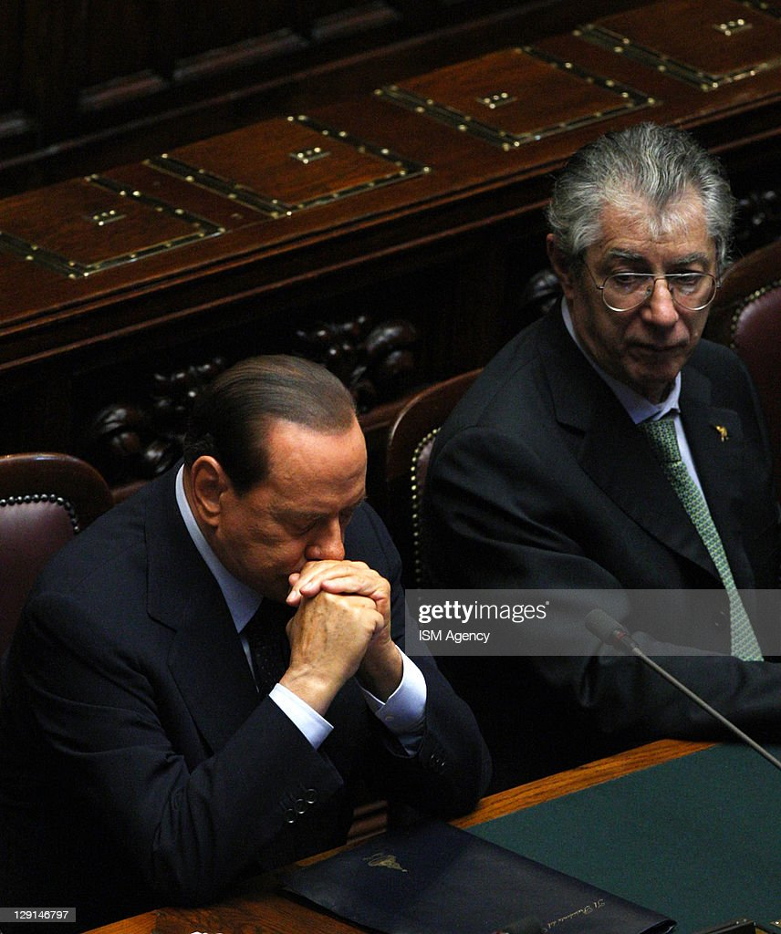 Italian Prime Minister <a gi-track='captionPersonalityLinkClicked' href=/galleries/search?phrase=Silvio+Berlusconi&family=editorial&specificpeople=201842 ng-click='$event.stopPropagation()'>Silvio Berlusconi</a>, Reforme Minister <a gi-track='captionPersonalityLinkClicked' href=/galleries/search?phrase=Umberto+Bossi&family=editorial&specificpeople=613296 ng-click='$event.stopPropagation()'>Umberto Bossi</a> atttend session of Italian Chamber of Deputies, at Palazzo Montecitorio on October 13, 2011 in Rome, Italy. The Italian Prime Minister addressed parliament today as he sought a vote of confidence in response to a statement from Italy's President Giorgio Napolitano expressing concerns over the unity of the coalition government.