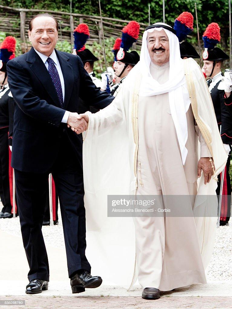 Italian Prime Minister Silvio Berlusconi shakes hand with Emir of Kuwait Sheikh Sabah AlAhmad AlJaber during a meeting at Villa Madama