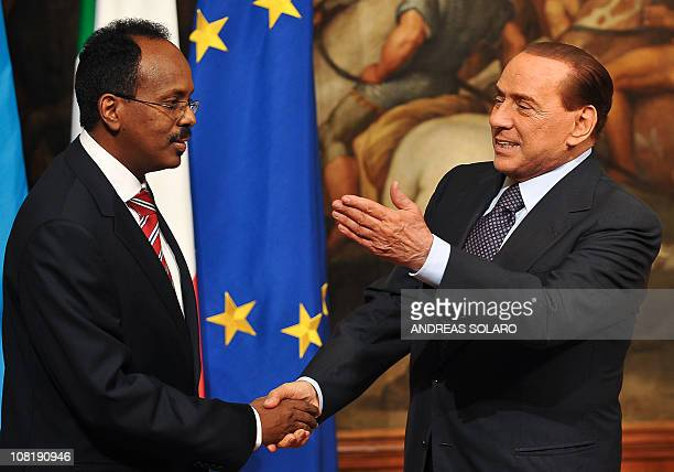 Italian Prime Minister Silvio Berlusconi shakes hands with his Somali counterpart Mohamed Abdullahi Mohamed before their meeting on January 20 2011...