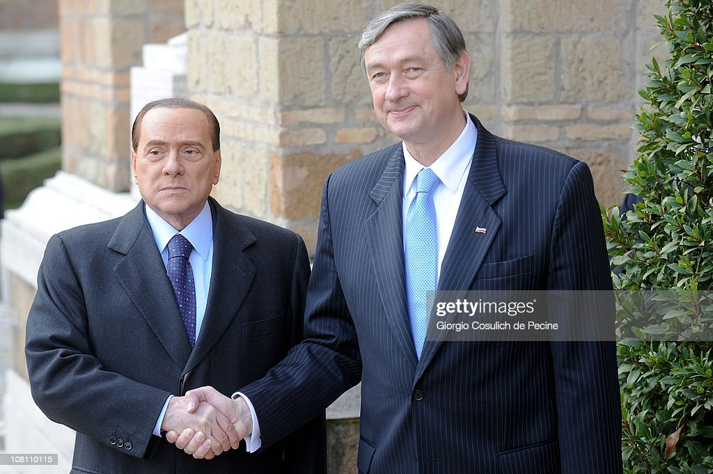 Italian Prime Minister <a gi-track='captionPersonalityLinkClicked' href=/galleries/search?phrase=Silvio+Berlusconi&family=editorial&specificpeople=201842 ng-click='$event.stopPropagation()'>Silvio Berlusconi</a> (L) shakes hands with President of Slovenian Republic, <a gi-track='captionPersonalityLinkClicked' href=/galleries/search?phrase=Danilo+Turk&family=editorial&specificpeople=5085526 ng-click='$event.stopPropagation()'>Danilo Turk</a> (R) in Villa Madama, on January 18, 2011 in Rome, Italy. This is Berlusconi's first official engagement since the controversy regarding the allegations of sexual relations with an underage girl.