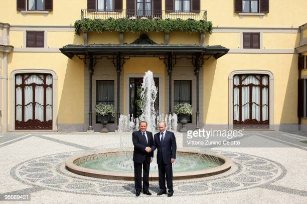 Italian Prime Minister Silvio Berlusconi shakes hands with Russian Prime Minister Vladimir Putin as they meet at Villa Gernetto on April 26 2010 in...