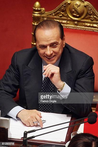 Italian Prime Minister Silvio Berlusconi smiles as he attends a Senate confidence session for his government in the Italian Senate May 15 2008 in...