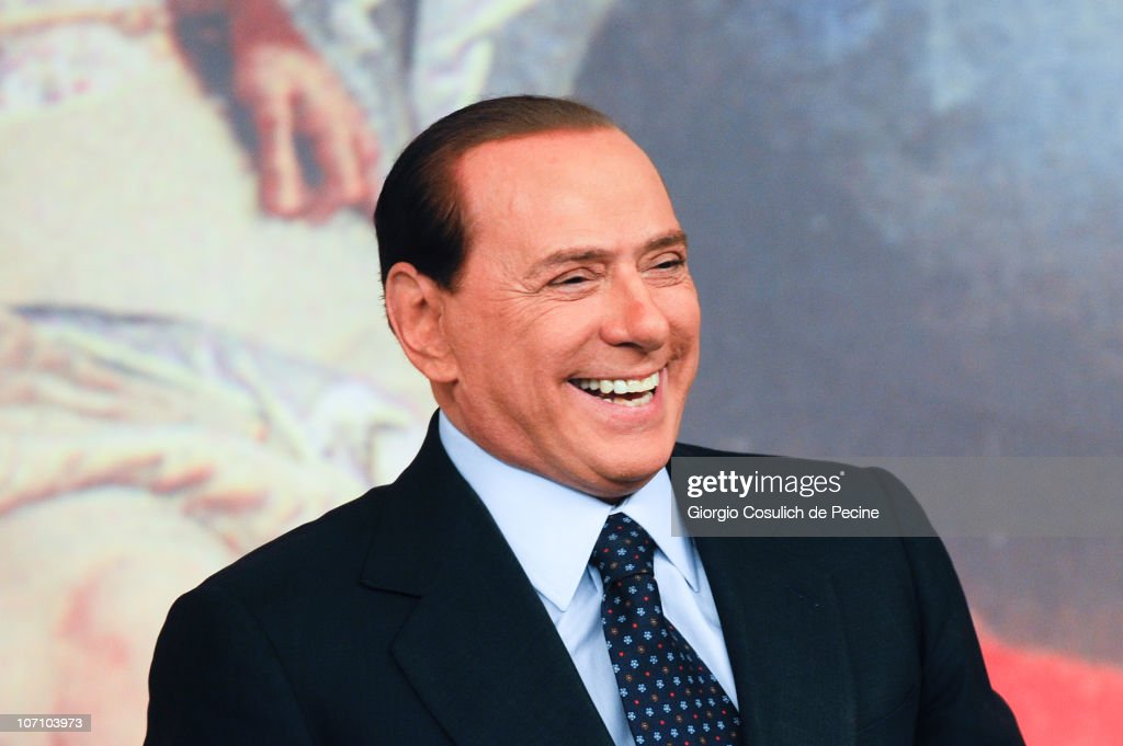 Italian Prime Minister <a gi-track='captionPersonalityLinkClicked' href=/galleries/search?phrase=Silvio+Berlusconi&family=editorial&specificpeople=201842 ng-click='$event.stopPropagation()'>Silvio Berlusconi</a> smiles during a press conference to present new government measures for the youngsters, called 'Right To The Future', to support their right to build a family in Rome's Palazzo Chig on November 24, 2010 in Rome, Italy. <a gi-track='captionPersonalityLinkClicked' href=/galleries/search?phrase=Silvio+Berlusconi&family=editorial&specificpeople=201842 ng-click='$event.stopPropagation()'>Silvio Berlusconi</a> will face a confidence votes session next December 14 in both the House of Parliament and the Senate.