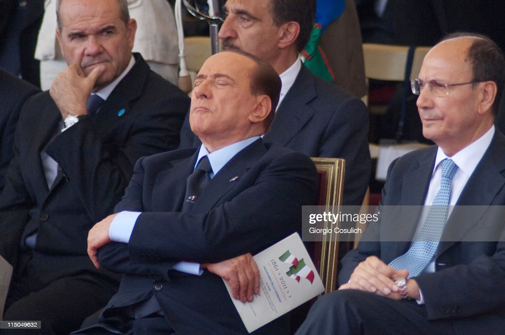 Italian Prime Minister <a gi-track='captionPersonalityLinkClicked' href=/galleries/search?phrase=Silvio+Berlusconi&family=editorial&specificpeople=201842 ng-click='$event.stopPropagation()'>Silvio Berlusconi</a> (C) takes a nap beside Italian President Senate <a gi-track='captionPersonalityLinkClicked' href=/galleries/search?phrase=Renato+Schifani&family=editorial&specificpeople=4851265 ng-click='$event.stopPropagation()'>Renato Schifani</a> (R) while attenting the military parade to mark the founding of the Italian Republic and the 150th anniversary of Italian unification at Via dei Fori Imperiali on June 2, 2011 in Rome, Italy. The Italian Republic was founded in 1946 after the death of Benito Mussolini. This year 80 foreign delegations from all over the world attended the Italian military parade.