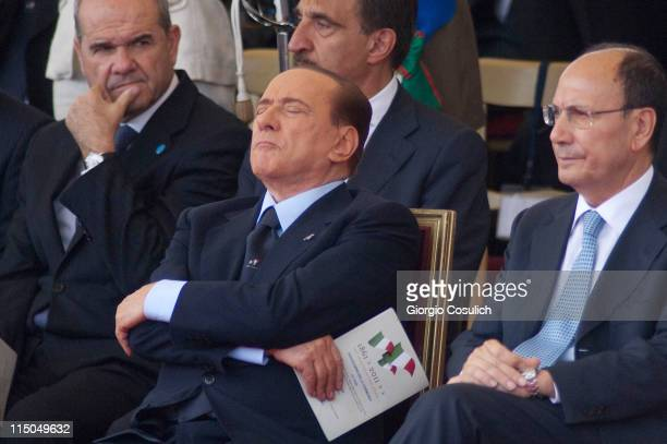 Italian Prime Minister Silvio Berlusconi takes a nap beside Italian President Senate Renato Schifani while attenting the military parade to mark the...