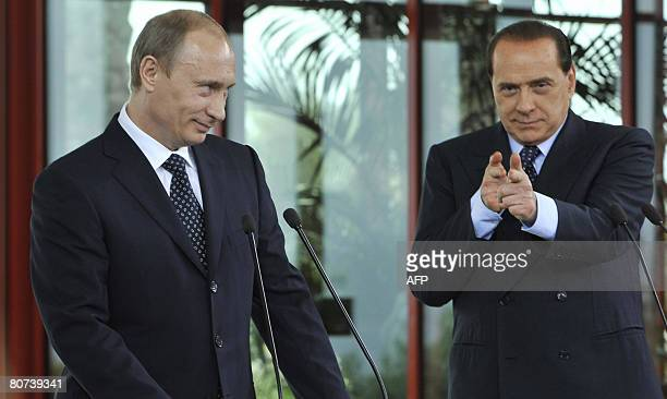 Italian Prime Ministerelect Silvio Berlusconi gestures to journalist during a press conference with Russian President Vladimir Putin at Berlusconi's...